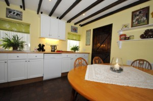 The newly decorated kitchen is a great space to spend time with the family around the dining room table.