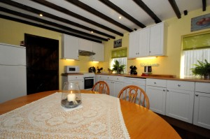 The cottage kitchen is well equiped with a 4 burner gas stove, dishwasher, fridge/ freezer, microwave oven, toaster, kettle and all the kitchen utencils you would need.